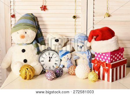 Toys placed on bureau on wooden wall background poster