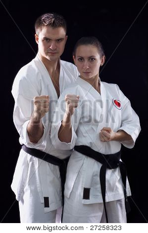 karateka couple on black background studio shot