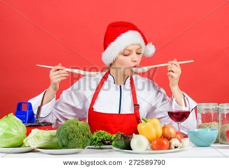 Healthy Christmas Holiday Recipes. Festive Menu Concept. Woman Chef Santa Hat Cooking Hold Wooden Sp