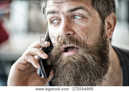 Man With Beard And Mustache Mobile Phone Conversation Defocused Background. Bearded Man Hold Mobile