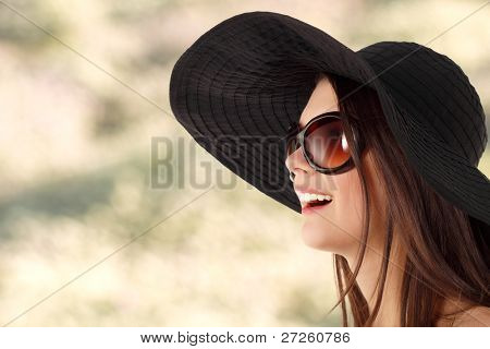 summer teen girl cheerful in panama and  sunglasses over nature background