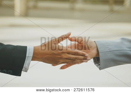 Business Partnership For Hand Holding After Meeting And Agreement. Successful Business, Blurred Back