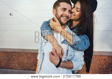 Young Beautiful Girl Hugging Her Handsome Boyfriend