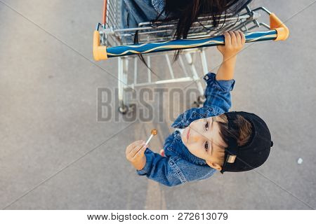 Little Boy Is Driving His Mother In A Cart.
