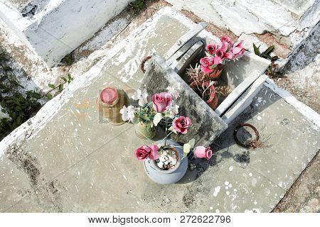 cemetary, tombestone and grave with plastic flowers. Latin America poster