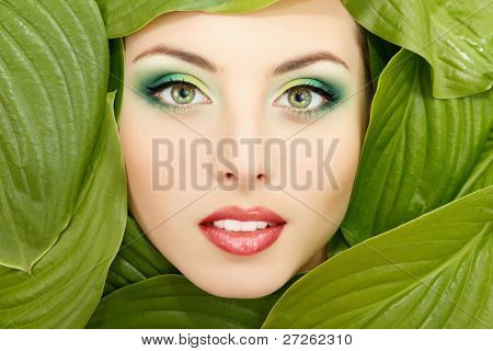 woman beauty face with green leaves frame isolated on white background