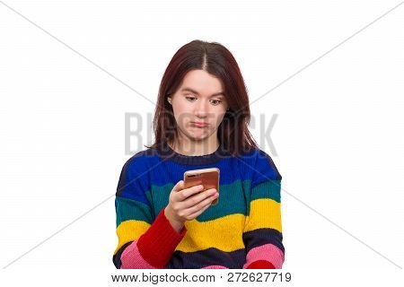 Emotional Shock As Cute Young Pretty Woman Standing Isolated Over White Background Using Mobile Phon