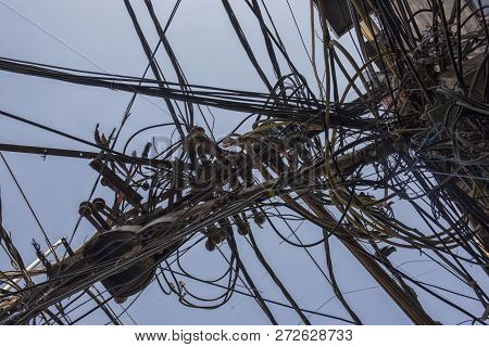 Wires Attached To The Electric Pole, The Chaos Of Cables And Wires On An Electric Pole In New Dehli,