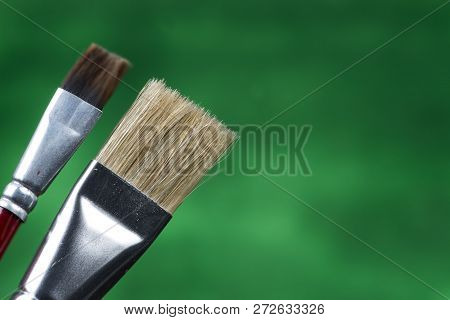 Detail Of Brush Bristles On Green Background.