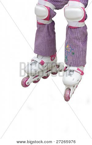 roller blades and safeguard on the legs of child