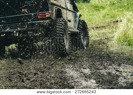 Leading Up Through The Extreme Trails. Suv Or Offroader On Mud Road. Car Racing Offroad. Offroad Car