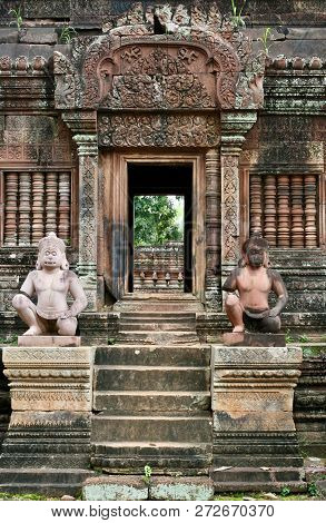 Doorway On An Ancient Jungle Ruin In Asia With Guardian Statues