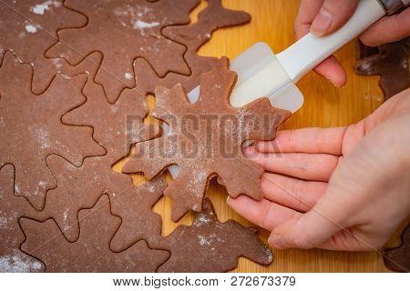 Star-shaped Cake Is Lifted By A Woman Hands With A White Spatula, The Preparation For Christmas Past