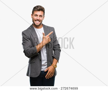 Young handsome business man over isolated background cheerful with a smile of face pointing with hand and finger up to the side with happy and natural expression on face looking at the camera.