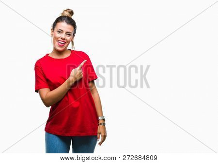 Young beautiful woman over isolated background cheerful with a smile of face pointing with hand and finger up to the side with happy and natural expression on face looking at the camera.