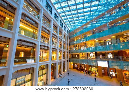 Tokyo, Japan - April 28 2018: Kitte Marunouchi Atrium Is A Huge Triangular Atrium: A Courtyard Space
