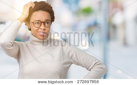 Young beautiful african american woman wearing glasses over isolated background confuse and wonder about question. Uncertain with doubt, thinking with hand on head. Pensive concept.