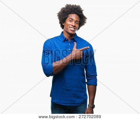 Afro american man over isolated background cheerful with a smile of face pointing with hand and finger up to the side with happy and natural expression on face looking at the camera.