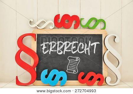 German word Erbrecht (inheritance law) as concept on blackboard with many colorful paragraphs