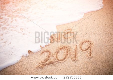 Inscription 2019 And 2018 On A Beach Sand, 2018 Will Be Ending.
