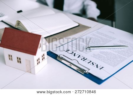 Home Insurance Concept With A Paper Document.