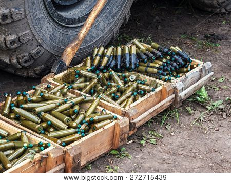 Many Wooden Boxes With Ammunition. Cartridge Tape. Cartridges From A Small-caliber Cannon Of A Tank