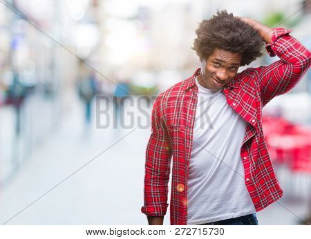 Afro american man over isolated background confuse and wonder about question. Uncertain with doubt, thinking with hand on head. Pensive concept.