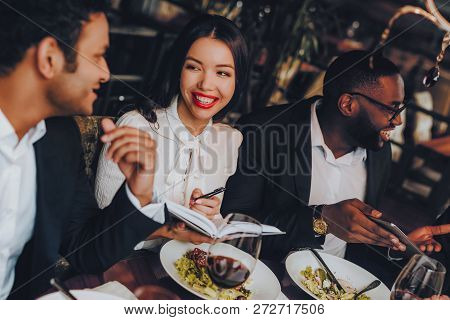 Business People Dinner Meeting Restaurant Concept. Businessmans Having Meeting In Indoor Restaurant.