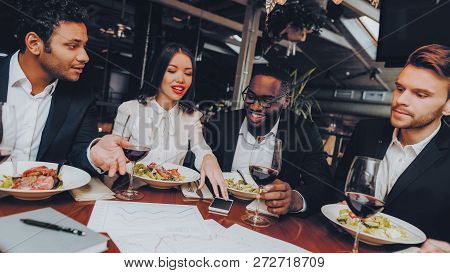 Business People Colleagues Corporate In Restaurant. Group Business People Geting Order In Restaurant