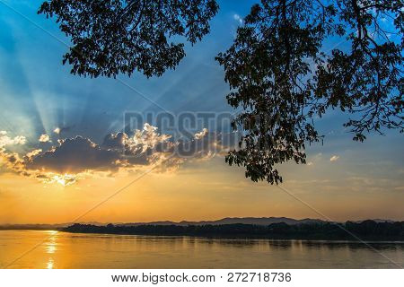 River Sunset / Landscape Of Beautiful Sunset On River Colorful Blue Sky With Tree Branch Foreground