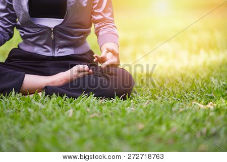 Yoga Woman / Young Girl Hand Doing Yoga And Meditation On Green Field - Relax Of Yoga In Park Outdoo