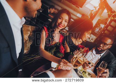 Group Happy Friends Enjoying Dating In Restaurant. Double Couple Dating In Restaurant. Romantic Coup