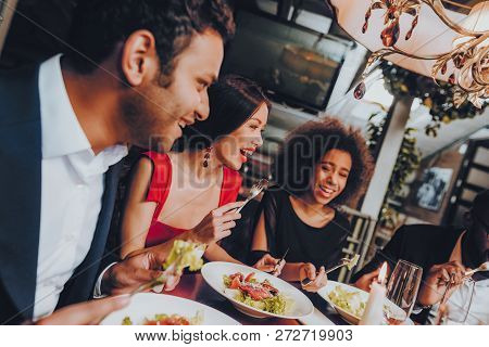 Group Of Happy Friends Meeting And Having Dinner. Celebrating With Friends. Party Dinner Table. Enjo