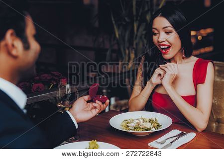 Hispanic Handsome Man Proposing To Girlfriend. Romantic Couple In Love Dating. Cutel Man And Girl In