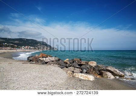 Beautiful Scenic View On Coast And Blue Sea Texture In Foreground.
