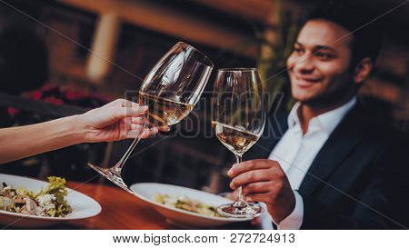 Cheerful Couple In Love Dating In Restaurant. Romantic Couple In Love Dating. Cheerful Man And Woman
