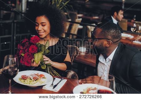 African American Couple Dating In Restaurant. Romantic Couple In Love Dating. Cutel Man And Girl In