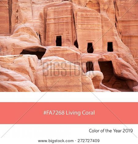 The cave dwellings of Petra as an example of the trend colour of the year 2019, Living Coral, with corresponding colour hex code.