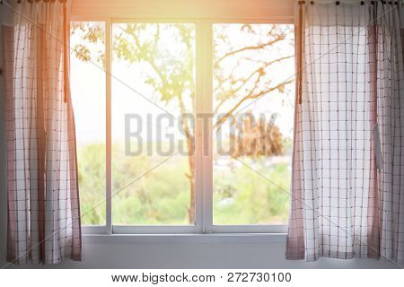 Bedroom Window In The Morning Room / Sunlight Through  Open Curtains Window Lights In The Room With