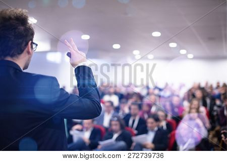 young businessman at business conference room with public giving presentations. Audience at the conference hall. Entrepreneurship club