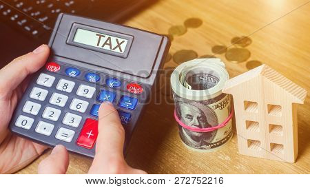 Inscription Tax On The Calculator. The Concept Of Paying Taxes For The Property. Liabilities Or Repa