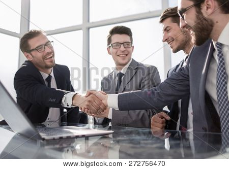 welcome handshake business partners in the office