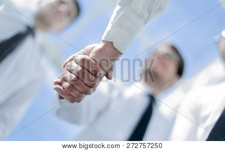 business background.handshake business partners
