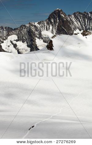 Team of alpinists crossing a glacier