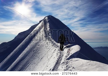 Alpinist on Monch Peak, Berner Oberland, Switzerland