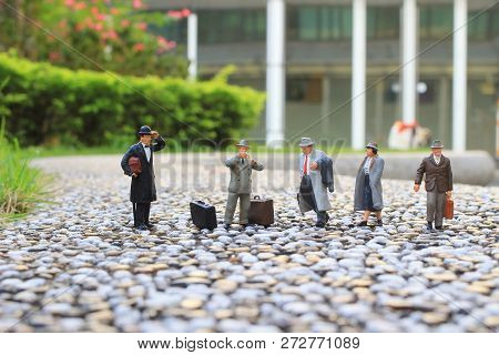 A Small Figures Business Men Stand On