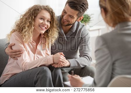 Young woman with anxiety and panic disorder laying on settee during meeting with her psychiatrist poster