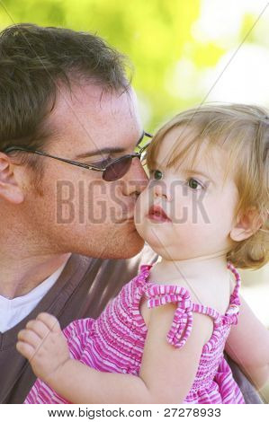 father and daughter ejoying a day at the park