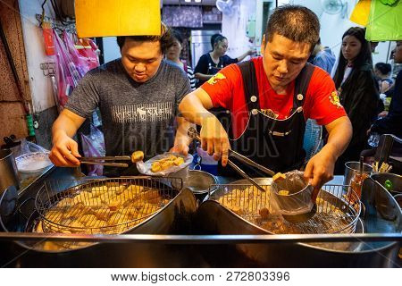 Jiufen, Taiwan - November 6: Two Men Cook Stinky Tofu At The Night Market Of Jiufen On November 6, 2