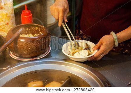 Jiufen, Taiwan - November 6: A Woman Serves Stinky Tofu At The Night Market Of Jiufen On November 6,